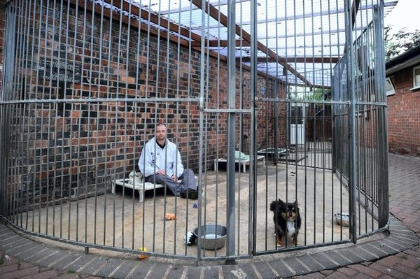 Sean Le Vegan hopes to raise awarness for kennel dogs by living in a kennel. Photo Credit: Paul Heyes