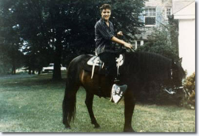 """Elvis Presley at Graceland in the 1950's. """"The King of Rock n' Roll"""" loved horses so much he purchased a ranch in Mississippi, the Circle-G, house the many horses he gifted to his friends./Photo credit: elvispresleymusic.com au"""