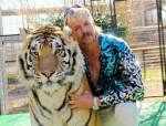 Joe Schreibvogel, GW Exotic Animal Park zoo owner, poses with tiger