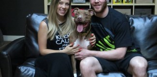 Chicago Blackhawks, Bryan Bickell, poses with his wife and pit bull.