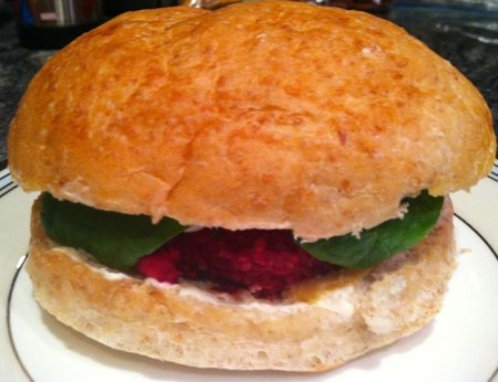 Chickpea, beet & quinoa burger on a whole wheat bun with spinach and thousand island dressing./Photo credit: Lisa Singer
