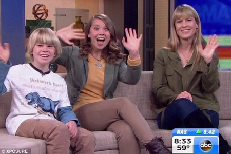 All smiles: The family of the late Crocodile Hunter Steve Irwin, Robert (left), Bindi (centre) and Terri (right) were on Good Morning America today. Bindi urged viewers to log into seaworldkids.com, and set off an avalanche of Twitter criticism over her partnership./Photo credit: Dailymail.com.uk