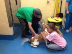 Dog reunites with guardians after Arkansas tornado at Maumelle Animal Clinic
