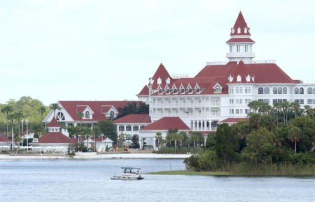 """A boat belonging to the Orange County Sheriff's office searches the Seven Seas lagoon ouside Disney's Grand Floridian Resort & Spa near Orlando, Florida on June 15, 2016. An American family's Disney vacation turned into a nightmare when an alligator snatched their two-year-old boy at the shore of a resort lake and the father was unable to pry the toddler from the animal's jaws, officials said Wednesday. Florida authorities believe there is """"no question"""" the two-year-old boy dragged into a man-made lake by an alligator at a Disney resort hotel in Florida is dead, Orange County Sheriff Jerry Demings said Wednesday.Rescuers were still working to recover the body, Demings told reporters. / AFP / Gregg NEWTON. Photo Credit: Gregg Newton/AFP/Getty Images"""