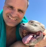 arthur-and-lulu-the-pitbull-smiling-together-at-dog-beach
