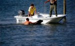 man-swims-to-nearby-boat-to-help-save-drowning-bear