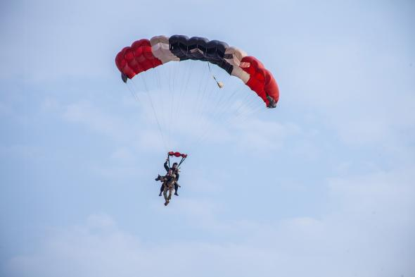 Africa's first skydiving anti-poaching dog, Arrow, does a demo jump from a helicopter at 6,000 feet. Photo Credit: Nico De Klerk