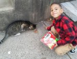 Boy helps street cats in Philadelphia