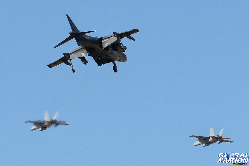 An Av-8B turns onto finals as two F/A-18Es from VFA-122 fly overhead. © Alan Kenny - globalaviationresource.com