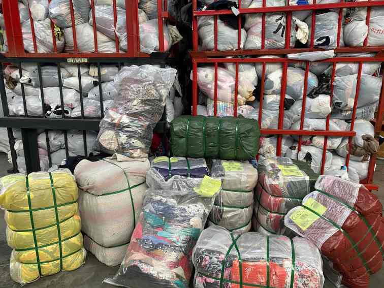 from unsorted clothes and shoes to packaged in bags or bales ready to export