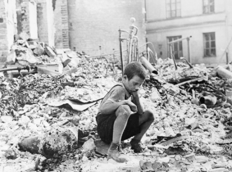 A boy amidst the destructions by war, international day of peace, global education magazine