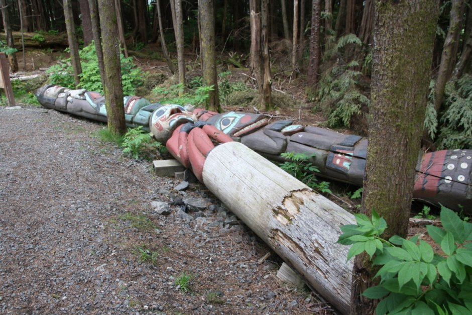 The totem poles are on the ground