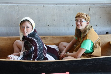 Sitting in a canoe wearing costumes