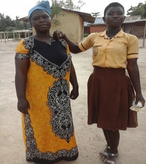 a mother poses next to her daughter in the Teen Girls Club