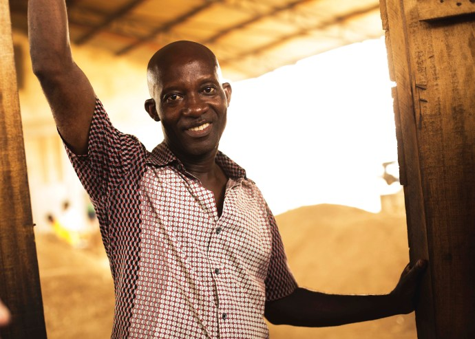 Man from Ghana named Osei smiles and poses for a picture