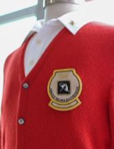 In recognition of Palmer's sartorial style, the winner of the Arnold Palmer Invitational now receives a red cardigan.