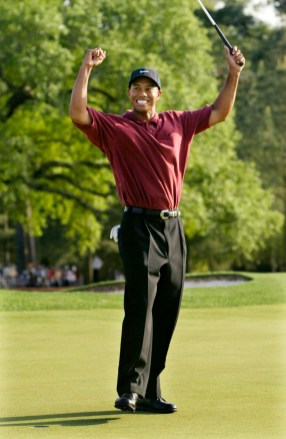 2002 Masters – Woods shot 12 under to become the third player (Nick Faldo, Jack Nicklaus) to defend a title successfully at the Masters. Retief Goosen, three shots back, was his closest competitor. (Photo: Gary Hershorn, Reuters)