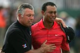 2006 Open Championship – Woods shot 18-under par to beat Chris DiMarco by two strokes at Royal Liverpool. He won a little more than two months after the death of his father, Earl Woods, and broke down in tears after sinking the final putt. (Photo: Andy Lyons, Getty Images)