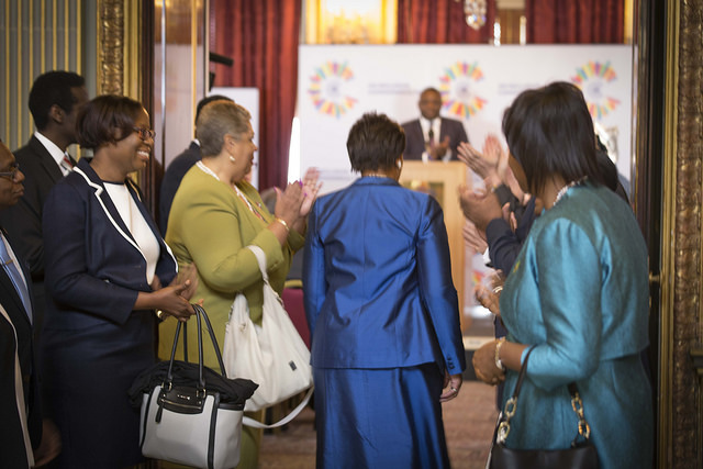 Commonwealth Secretary-General, Rt Hon Patricia Scotland QC, being applauded as she enters the main conference room at Marlborough House