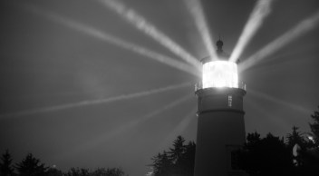 Lighthouse Beams From Lens Rainy Night Pillars of Light