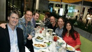Dr. Edward Group having lunch with presenters, founder Ty Bollinger, and wife Dr. Daniela Group at The Truth About Cancer Symposium.