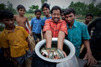 Fishermen in Bangladesh display a small bit of their catch - Paul Joseph Brown Global Health Photography - Public Health Photography