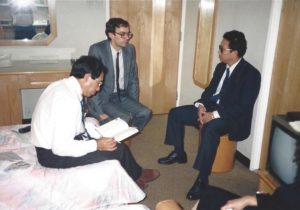 Saboi Jum and Dan Buttry meet with KIO Chairman Brang Seng in a hotel room in Hong Kong during secret talks.