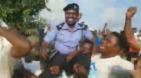 EndSARS Protesters Carry And Celebrate Policeman Who Saved A Woman From Being Attacked By A Mob At End SARS Protest In Abuja