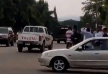 Video Of Thugs Being Teargassed In Abuja As They Attempt To Loot Covid-19 Palliatives