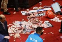 Taiwan's opposition legislators have thrown pig guts and exchanged blows in parliament amid a heated row over the easing of US pork imports