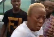 Video Of A Female Fake Bank Alert Scammer Caught In Edo State And Beaten Blue Black