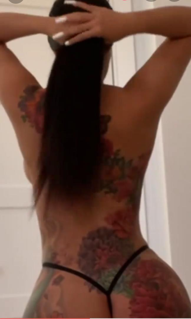 Video of Cardi B stripping down to her g-string to show her huge tattoo bum