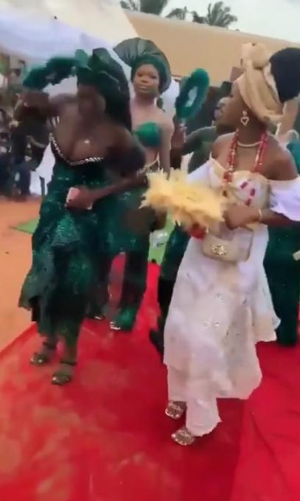 Video Of Money Raining On A Busty Lady's Breasts As She dances Alongside A Bride At A Wedding