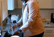 Video Of Senator Dino Melaye Washing The Dishes And Preparing Food For Himself Abroad