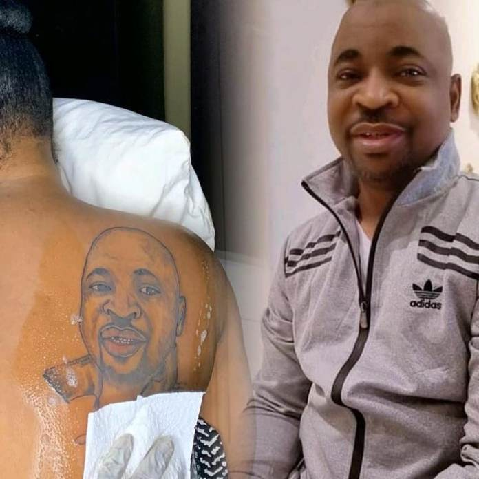 Video Of A Lady Tattooed MC Oluomo's Face On Her Back