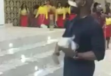 Video Of A Young Man Spraying Bundles of Money On His Pastor In Church