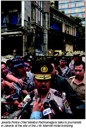 Jakarta Police Chief Makbul Padmanegara talks to journalists in Jakarta at the site of the J.W. Marriott Hotel bombing, 14 August 2003. [AFP photo]