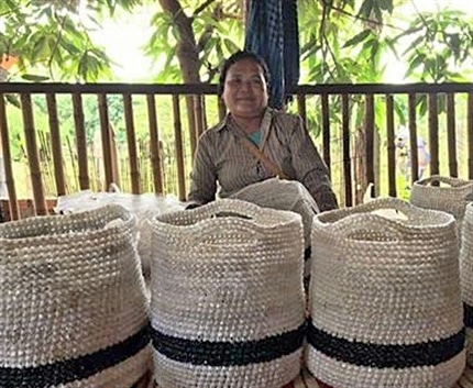 Woman with finished products at Cambodia Womens Empowerment Project