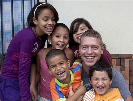 Happy Volunteer and children at the Colombia Kids Project