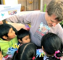volunteer with students at community project