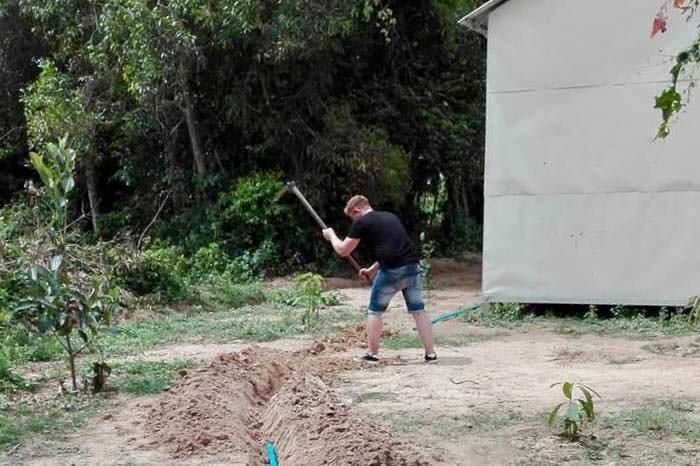 Volunteer helping in the gardens in Siem Reap