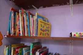 providing books for students at after school project just outside Cusco Peru