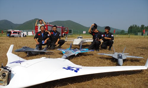 Liu Yang and his team pose with their drones.<br /> Photo: Courtesy of Chen Xiao