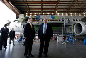 LEARNING TO FLY Gov. Rick Bentley (left of center) with Commerical Jet president David Sandri. Alabama's business climate and incentives lured Airbus to Mobile, where it benefits from recent upgrades to the city's port.