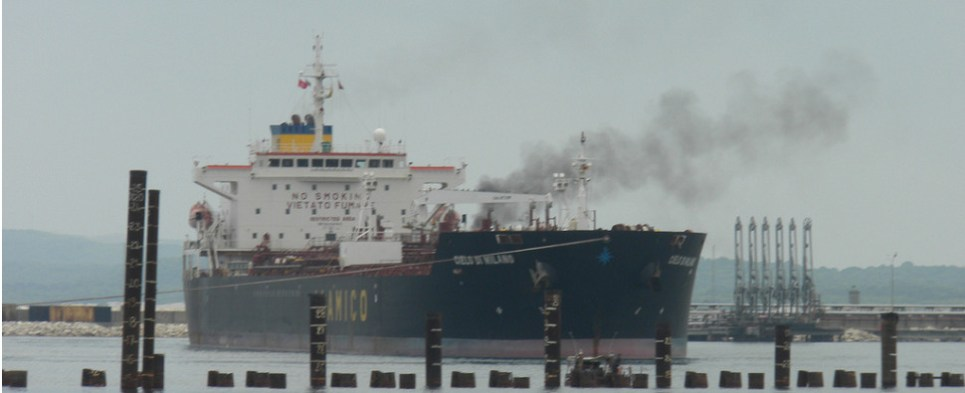 Defendant convicted of polluting sea while shipments of export cargo and import cargo in international trade.