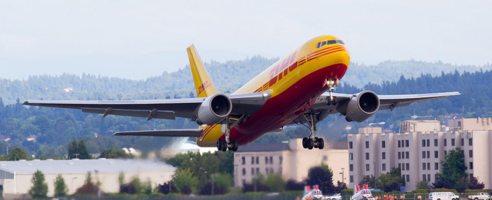 DHL EXpress delivering ecommerce shipments of export cargo and import cargo in international trade.