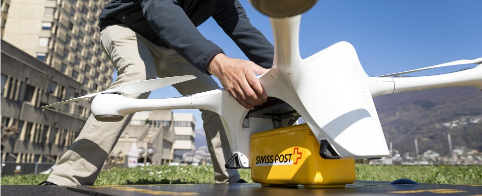 Drones delivering shipments of export cargo and import cargo in international trade.