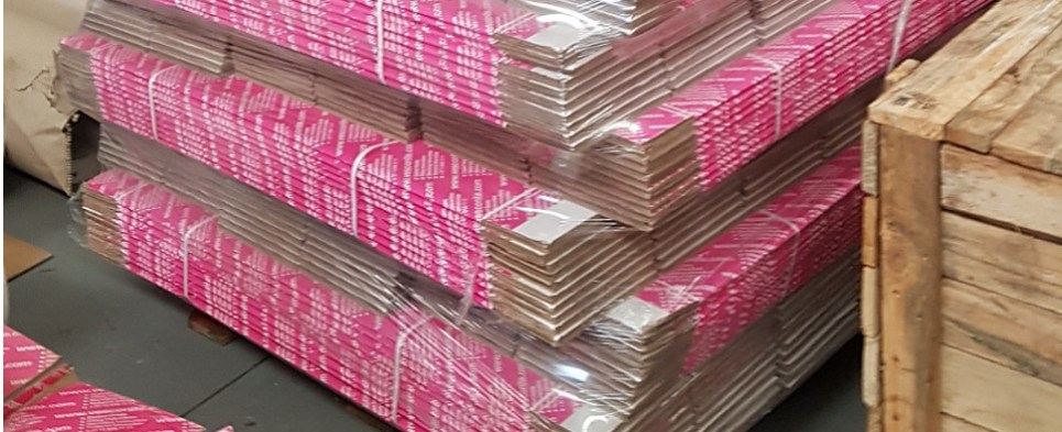 Shipper uses pink packaging for shipments of export cargo and import cargo in international trade.