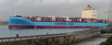 AI system being tested on ocean vessel that carries shipments of export cargo and import cargo in international trade.