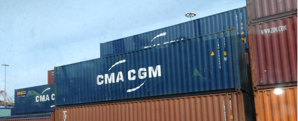 System tracks container shipments of export cargo and import cargo in international trade.